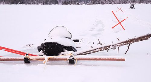 The Temiskaming Speaker - Lake Temagami resident's sled goes through ice